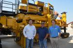 Logan Hawethorne (L) and Ken Larkin (C) of Fort Worth's AUI Partners; and Gabe Huckabey, ROMCO project manager are pictured with a GOMACO paver ready for delivery at the Carrollton facility.