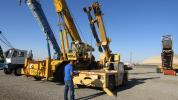 Pete Delgado of Rio Materials, La Grange, Texas, does one more assessment before bidding starts for this 1997 Grove AP410 10-ton 4x2x4 carry deck crane.