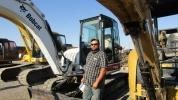 Dennis Tallerdy of Last Drop Drilling and Pump, based in Cedar City, Utah, takes time to inspect a 2004 Bobcat 442C midi excavator to add to the company's fleet.
