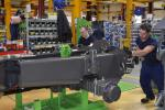 In the early phase of production, a model 12MTX begins its journey on the Mecalac assembly line.