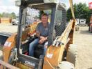 Mike Flowers of Tri-State Equipment placed the winning bid on this Case skid steer and prepares to take it  back home to Michigan.