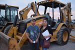 Oscar and Araceli Perez of Garfia's Auto Sales in Houston looked at this Cat 420D and a host of other backhoe loaders.