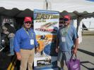 Eager Beaver's Randy Hall (L) catches up with customer David Aldridge from the city of Highpoint, N.C., at the show.