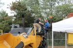 Joseph Spee (L), territory manager of Caterpillar Paving Products, assists Christopher Vecchia, president of Suffolk Asphalt in Medford, N.Y.