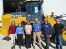 (L-R): Caroline Rafferety, John Deere; Mary Kay, Brooks Tractor general manager; Megan Hargrave, John Deere; Jay Getka, city of Kenosha; Dan Goeden, Milwaukee County; and John Blonien, Milwaukee County, stand in front of the John Deere 624K wheel loader.