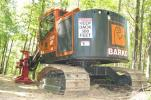 The woods were filled with demo machines and static display machines, including this Barko 240 tracked feller-buncher