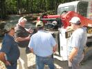 Takeuchi's Dennis Parker (C) goes over the power plant and the overall serviceability of the Takeuchi TL12V2 compact track loader.