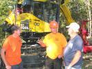 Darrek Copeland (C) of C&L Logging Inc., Livingston, Tenn., talks about this Komatsu XT460L-3 with Travis Revis (L) and Dean Revis of Revis Logging based in Lester, N.C.