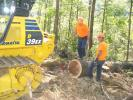 The C&L Logging crew uses a Komatsu D39EX dozer with specialty winch to demonstrate the process of winch-skidding timber on extremely steep embankments.