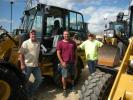 (L-R): Mike Stine, Kevin Martin and Jeff Layton, all of Love Point Ventures, Stevensville, Md., purchased this Cat 908 H2 at the Alban Cat-A-Thon.