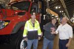 Admiring the features of an International vocational truck (L-R) are Chris Sherwood of the village of Manlius; Jeff Lewis of the Village of Manlius; and Matt Brayman of Stadium International.