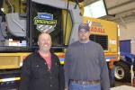 Checking out the latest features of the Gradall excavator are Dan Bobnick (L) of the town of Hartwick and Bill Hriver of the town of Otego.