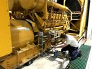 Jeremy Foster, Carolina Cat power generation technician, repairs a diesel fuel issue on a generator.