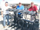 This Virnig root rake grapple sold at the show. (L-R) are Eric Easter, Ross Waterman, and Curtis Goettel, all of Virning, based in Rice, Minn.