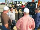 Eric Floyd (C), Bobcat and Doosan dealer representative of Rental Inc., Dothan, Ala., provides valuable information on product offerings for the agricultural industry.