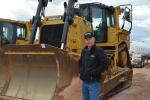 Justin Coleman, West Texas account manager of Worldwide Machinery, inspected the long line of dozers, including this Cat D8T.
