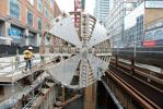 The cutting head of one of two tunnel boring machines is hoisted out of the extraction shaft.