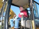 Cliff Campbell of C&C Equipment, Hattiesburg, Miss., test operates a Cat 320C in the sale lineup.