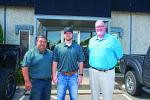 """Blue Star Utilities Owners Jose Guamancela and Steve Hugdahl meet with Kirby-Smith Machinery Territory Manager Bill Hitchcock at Blue Star's office in Mansfield, Texas. """"Bill and Kirby-Smith stepped up and were willing to help us grow, so we purchased three packages from them and have three more on rental purchase option."""""""