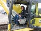 Joe Crain of Goodman's Lawn & Landscape puts a Komatsu PC450LC excavator through its paces at the auction.