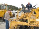 Local paving professionals, Spencer McCroskey (L), Sunbelt Asphalt, Auburn, Ga., and Harry Cassarino, Blackjack Paving, Tyrone, Ga., inspect this a Blaw Knox 3200 paver.