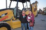 Oscar (L) and Araceli Perez traveled to Fort Worth from Houston to bid on backhoe loaders. The couple, who represent Garfia's Auto Sales, are interested in this Cat 416E.