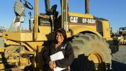 Emilia Castillo, owner of Castillo Plaster in Palmdale, Calif., was planning on purchasing a variety of different machinery. Castillo noticed this Cat vibratory padfoot compactor and paused to take a closer look.