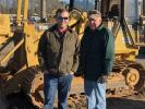Joe Woods (L), The Ironpeddlers, Fountain Inn, S.C., and his father, Barry, look  over this Cat 939C crawler loader.