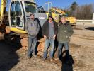 (L-R): Don Walls, Walls Rentals in Piedmont, S.C., and Justin and Bob Walker, both of Walker Land Clearing in Piedmont, S.C., inspect a Kobelco excavator.