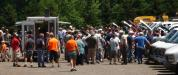 Bidders swarm around the auction truck as it goes to each lot of equipment up for bid.