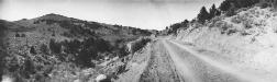 A view of the new Federal road in Austin, NV, through the Toiyabe National Forest. Note old trail down in wash; old trail grades 10 to 12 percent, maximum on new road 6 percent (Oct. 1, 1920). (Photo courtesy Lincoln Highway Collection, Special Collections Library, U. of Michigan)