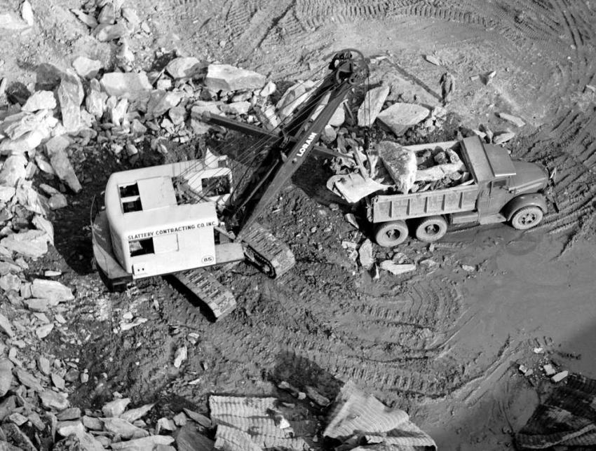 Author's Photo Collection A view of the Lorain 820 shovel shot from above. The shovel is loading rock into a Slattery Mack LJ ten wheeler. Note the blasting mats in the foreground. Slattery used a Northwest 80-D, a Bucyrus-Erie 38-B and two Lorain 820 shovels on the project.