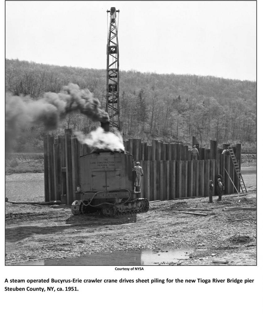 NYSA photo A steam operated Bucyrus-Erie crawler crane drives sheet piling for the new Tioga River Bridge pier Steuben County, N.Y., ca. 1951.