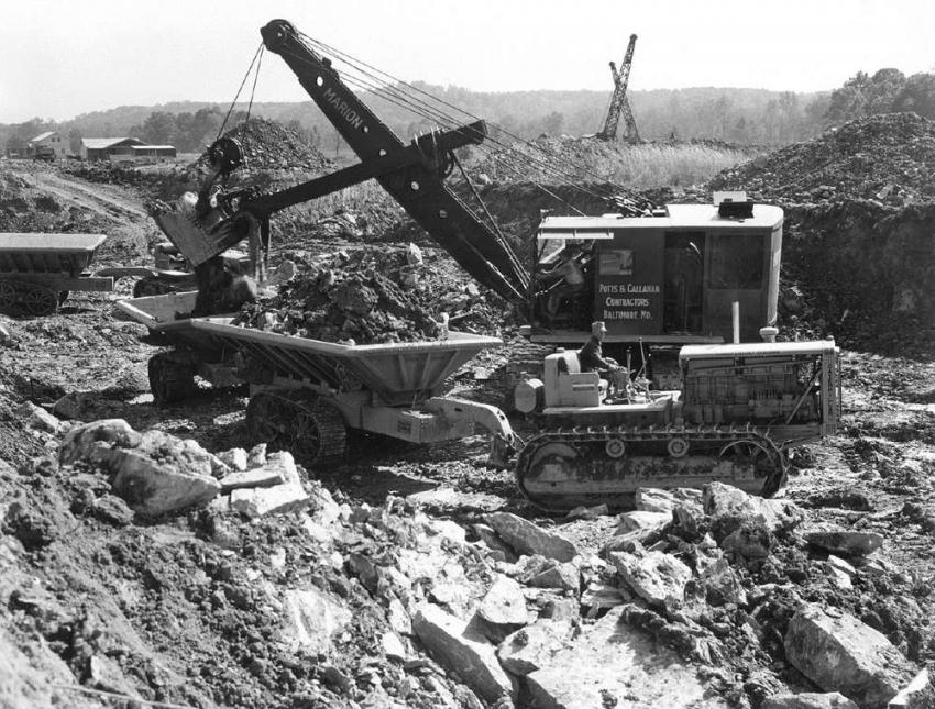 Potts & Callahan used a Marion power shovel to load rock and dirt into tandem Athey tracked dump wagons pulled by Caterpillar RD-8 tractors. The photo was taken during October 1937. (Caterpillar Tractor photo)