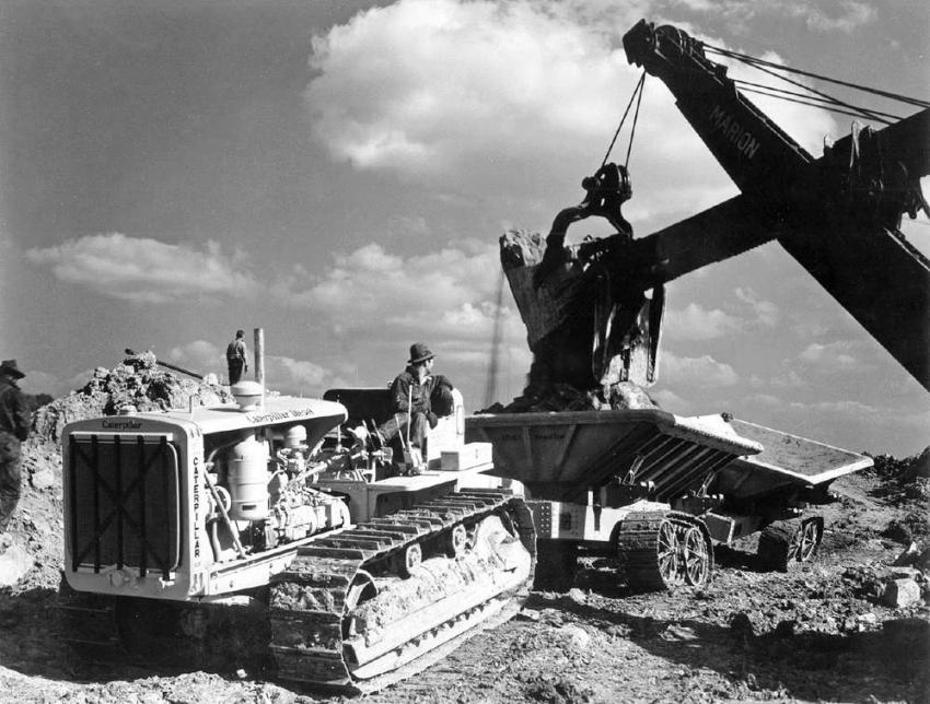 The heavy excavation continues with the Marion shovel filling the Athey wagons. The photo was taken during October 1937. (Caterpillar Tractor photo