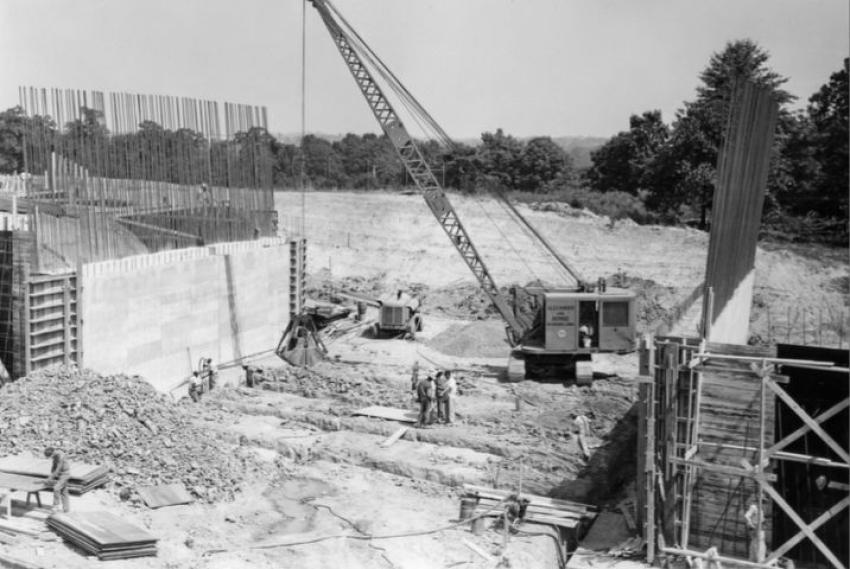 Alexander and Repass building the South Dakota Avenue bridge in July 1953. A Koehring 401 crawler crane is excavating footings with a clamshell bucket. The work was part of the Baltimore-Washington Parkway construction.