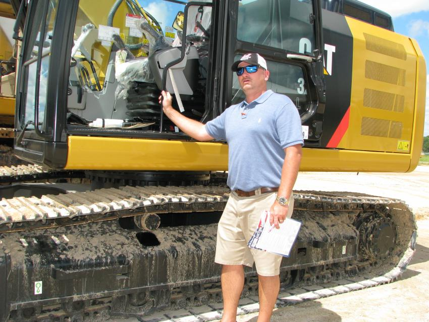 Getting ready to hop in to check out new Cat 320FL with only 6 hours is Jackie Atkinson, of J&J Truck Sales, Danville, Va.