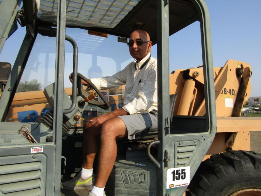 Ali Tashakori, owner of AT Construction in Palo Verde, Calif., looks over this JCB 508-40 Loadall telescopic forklift.