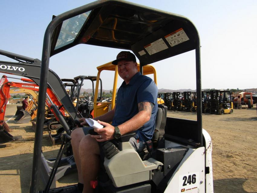 Chris Collinsworth of Pacific Construction, Fontana, Calif., evaluates this 2011 Bobcat 324 mini excavator.