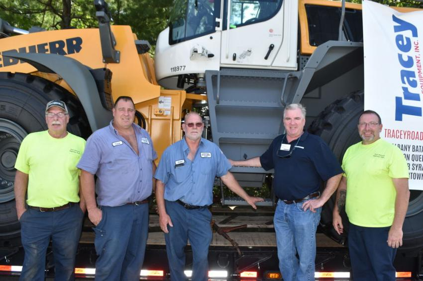 Checking out the latest and greatest Liebherr totally hydrostatic loaders (L-R) are Tom Plude of the town of Fort Edward highway department; Frank Colvin of the town of Fort Edward highway department; Brian Brockway, highway superintendent of the town of Fort Edward highway department; Kevin Murphy, Liebherr factory representative; and Chuck Bumb of the Fort Edward highway department.