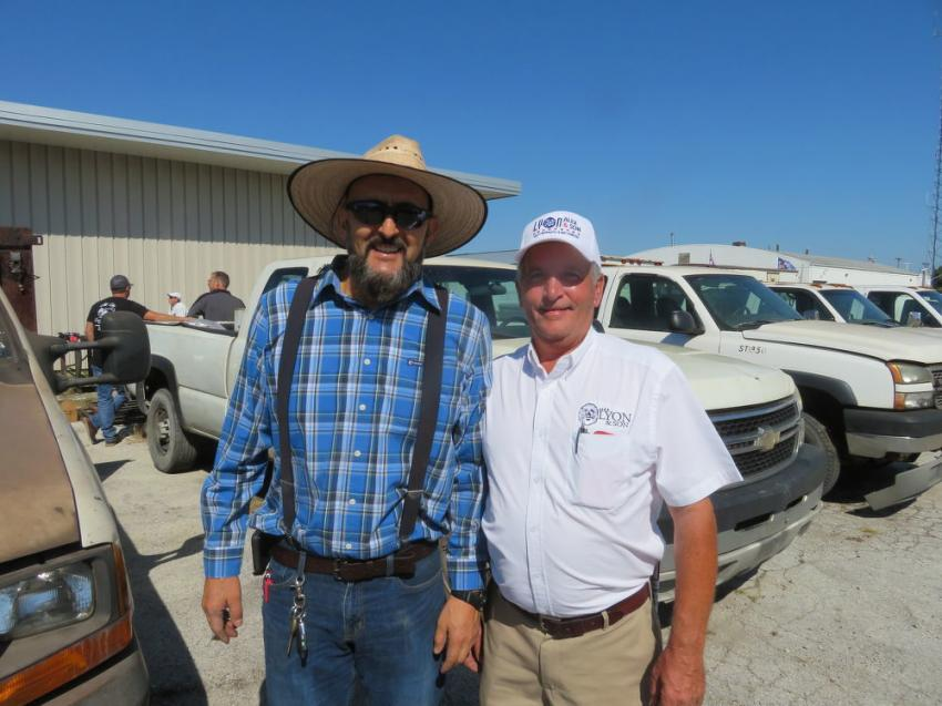 Dean Adsit (R) of Alex Lyon & Son helps Mario Figueroa, Figueroa Corporation, with some of the specs on the trucks he was interested in purchasing.