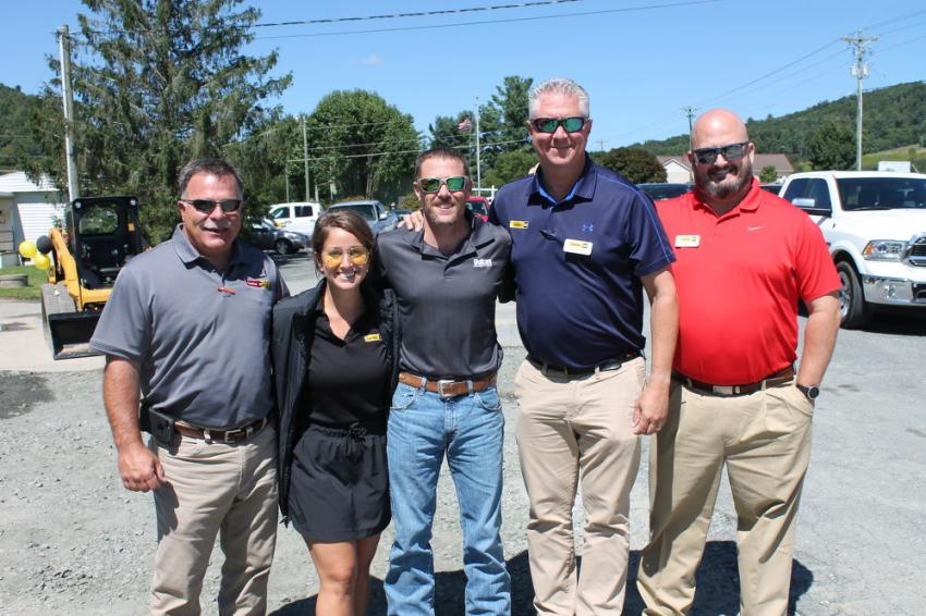 (L-R): Lloyd Baldwin, Carolina Cat Rental; Caroline Marston, Carolina Cat marketing coordinator; James Bear, plant manager of Vulcan Materials locations in nearby Boone and North Wilkesboro, N.C.; Mitch Christenbury, Carolina Cat corporate account manager; and Mark Kincer, Carolina Cat sales manager of Western N.C., are ready to greet customers and answer questions at the open house.