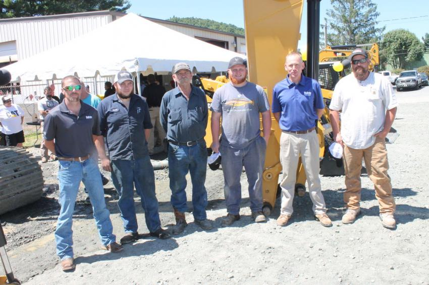 (L to R): The Vulcan Materials crew — James Bear, Boone and North Wilkesboro, N.C., plants manager; Takoda Holman, mobile equipment mechanic; Randall Robinson, mobile equipment mechanic; Jacob Wood, mobile equipment mechanic; Brian Parker, North Wilkesboro plant supervisor; and Casey McMahon, Boone plant supervisor — are ready to see the newest Caterpillar equipment.