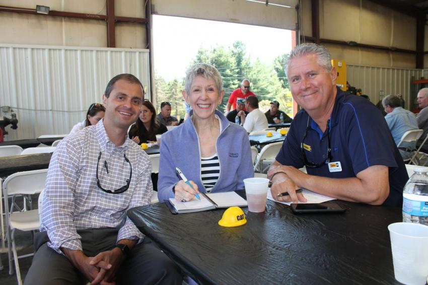 (L-R): Mike Tropsha, VP and GM of Carolina Cat's Construction Division; Agnes Weisiger of Carolina Cat; and Mitch Christenbury, Carolina Cat corporate account manager, take care of business at the open house event.
