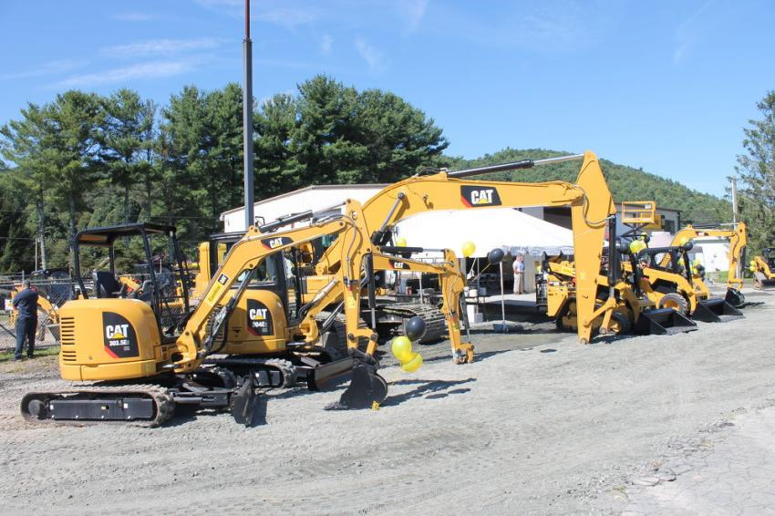 (L-R): Caterpillar 303.5E2 CR and 304E2 CR mini-excavators are on display with a 323 medium excavator at Carolina Cat's open house.