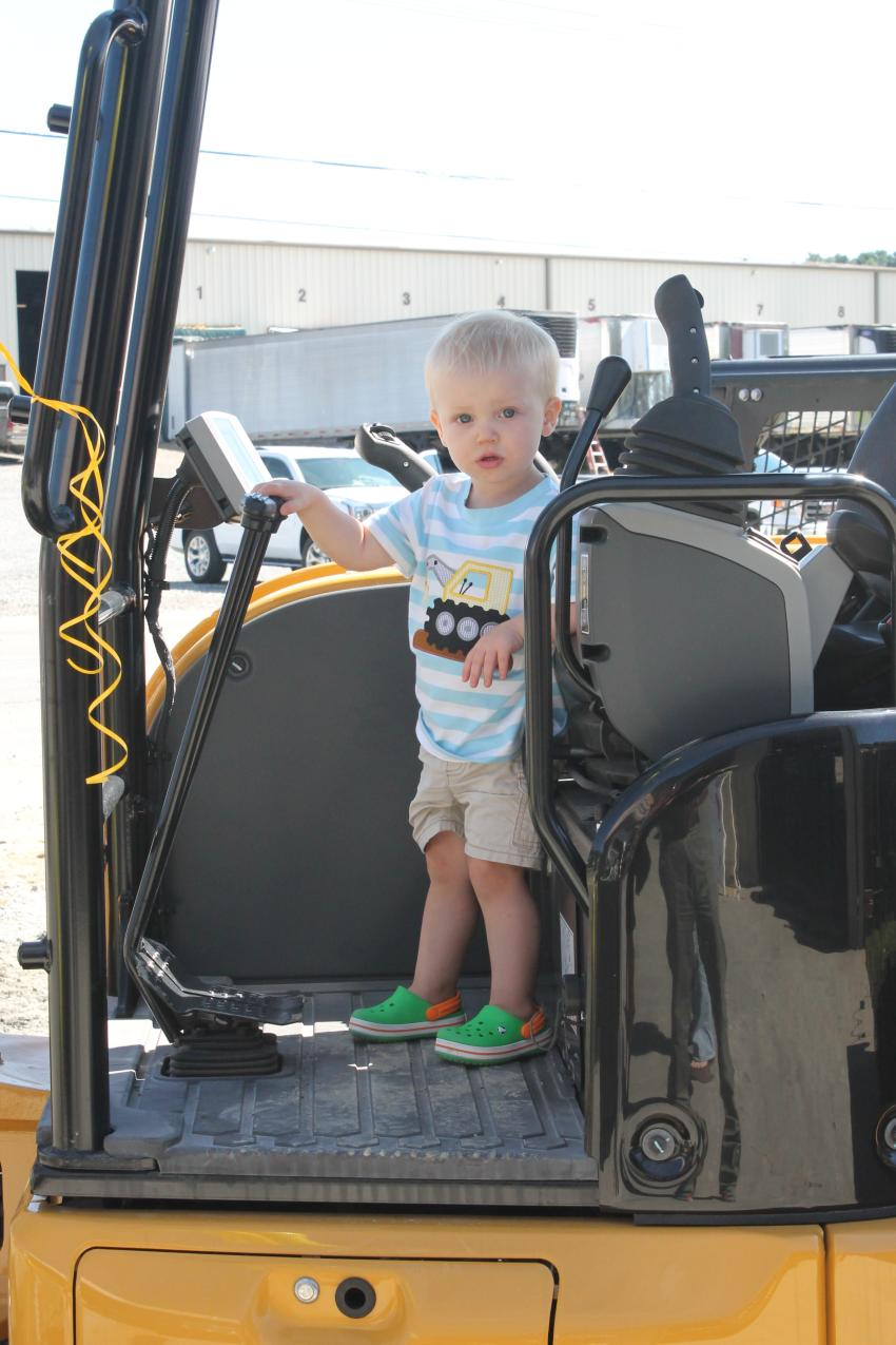 Two-year-old Wade Sparks and his twin sister, Charlotte, test the Cat 305.5E mini excavator. Their parents, Leslie and Yancey Sparks, own a farm in Sparta, N.C.