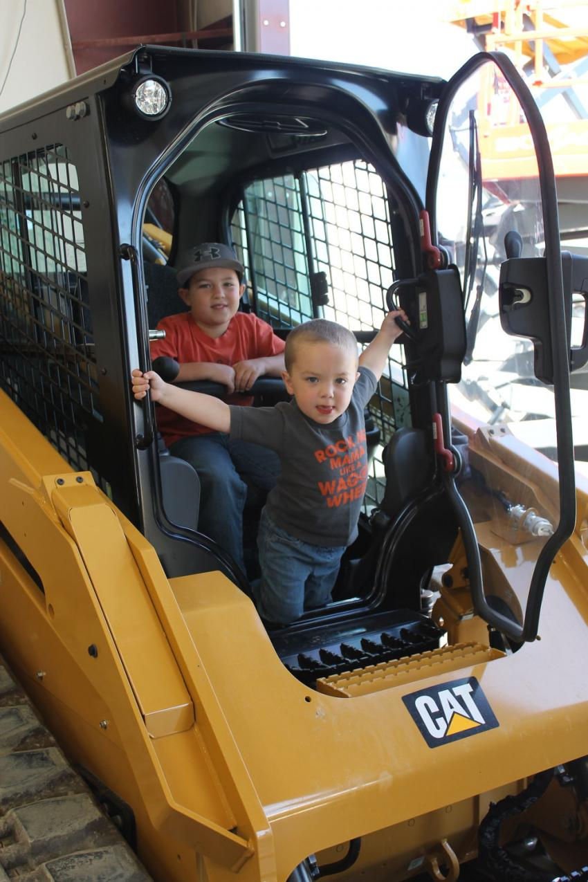 Easton Ellis (top) age 7, and Karson Ellis, age 2, of Hickory, N.C., seem to know their way around this 289D compact track loader. Their folks are Dillon and Beth Ellis.