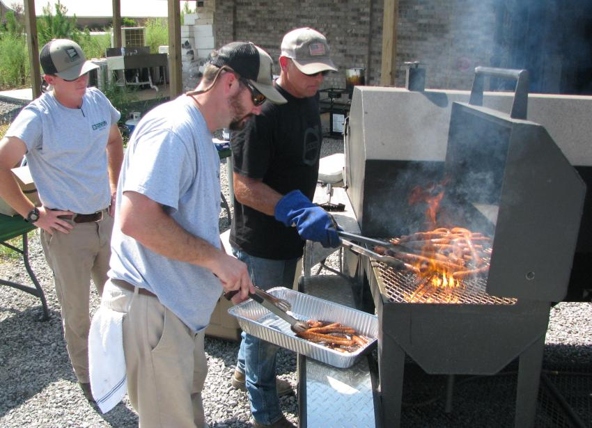 The Cowin grilling team traveled to this event to make sure the crowd was well fed. (L-R) are: Blake Walker, Brantly Clay and Todd Roberts of Cowin Equipment's Birmingham, Ala., headquarters location. Tim Jenkins, of the Huntsville, Ala., branch, was too busy grilling to be photographed.