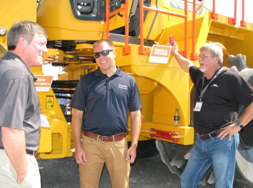 Talking about the new machine (L-R) are: Lance Sanders, Waste Management, Lake, Miss.; Todd Cannegieter, Volvo product support manager — special applications, Shippensburg, Pa.; and Gary Jones, also of Waste Management.