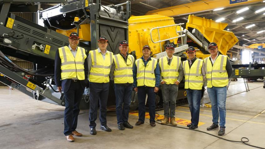Groff Tractor and Rubble Master teams in front of a scalper screen ready to be shipped to the United States. (Rubble Master photo)
